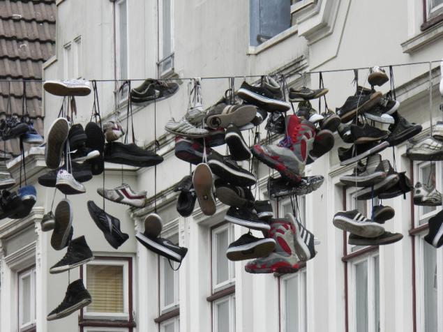 Shoes hanging over a street, Flenburg, Germany