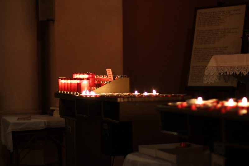 Candles, San Giovanni Battista church in Gradara, Le Marche, Italy