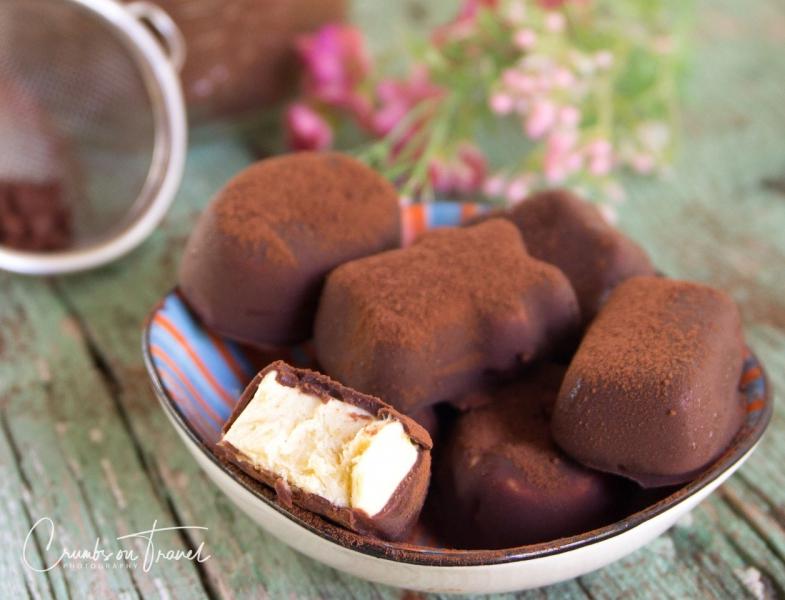 Icecream confect with peach vanilla and a chocolate coat