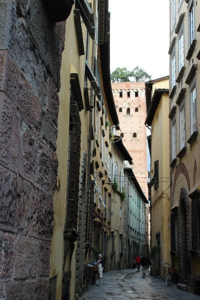 Street and the Giunigi tower in Lucca, Tuscany