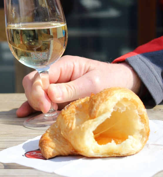 Half croissant and a glass of wine at Peglio, Le Marche/Italy