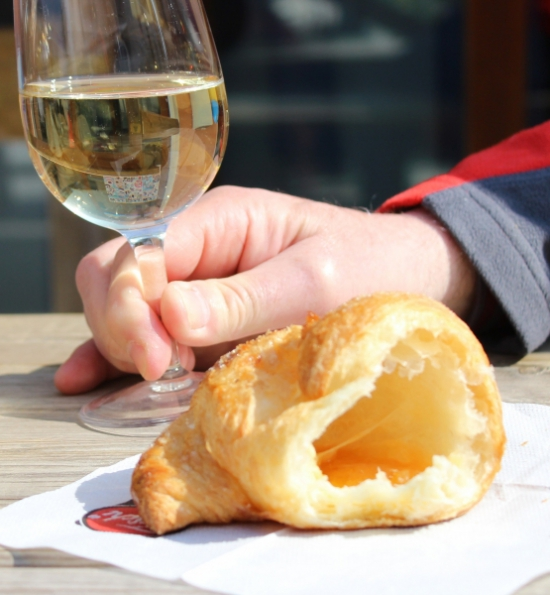 Half croissant and a glass of wine at Peglio, Le Marche/Italy