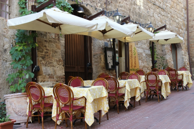 Dinning in the streets of San Gimignano, Tuscany