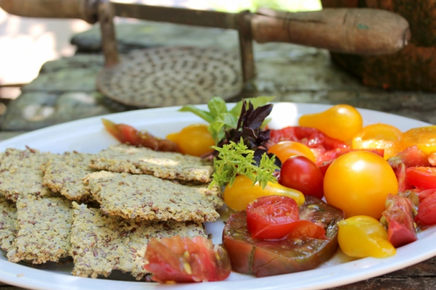 Paleo seeded crackers with fresh tomatoes