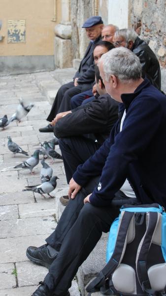 Men sitting in Taormina, Sicily/Italy