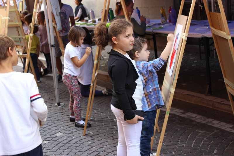 children painting, truffle festival Sant'Angelo in Vado, Le Marche, Italy