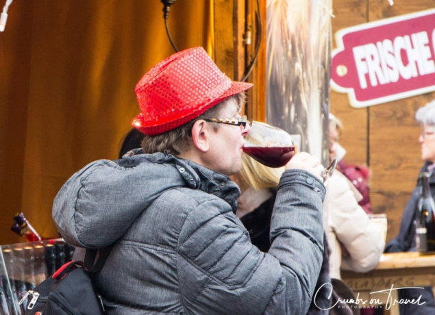 Enjoying a glass of wine on a Xmas market in Vienna/Austria