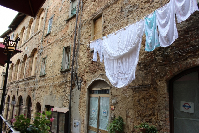 Washing in the streets of Volterra, Tuscany