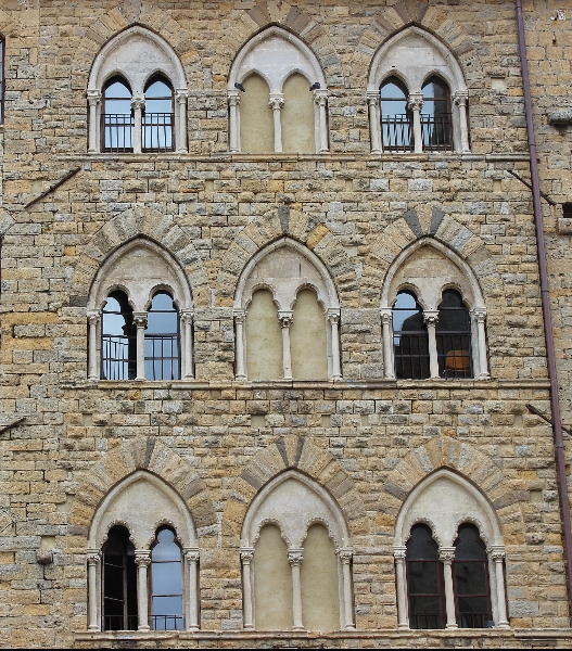 Medioeval windows in Volterra, Tuscany