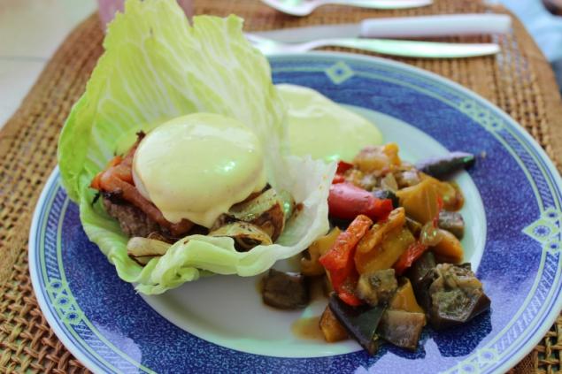Hamburger with mayonnaise and veggies