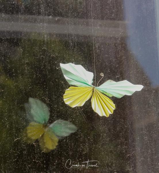 Paper butterfly in a window in Wismar