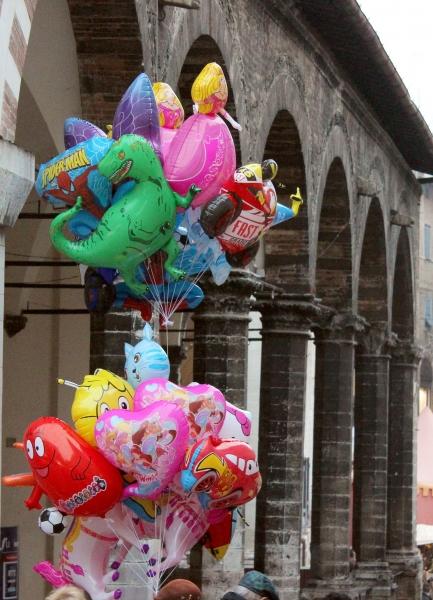 Balloons at a Christmas market, Urbino, Italy